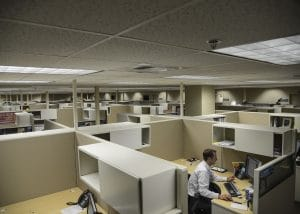 man working alone in an office