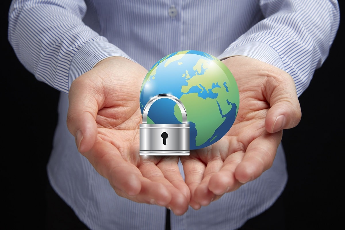 hands holding up graphic image of globe and padlock