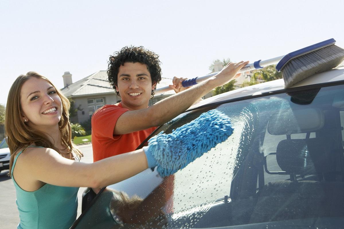 people washing a car